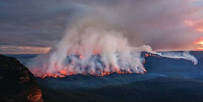 Fire and smoke over a mountain